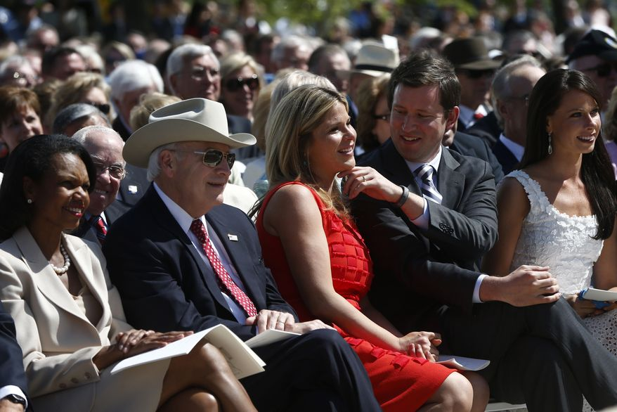 Former President George W. Bush's daughter, Jenna Bush Hager, center, is seated with her husband Henry Hager, second right, sister Barbara Bush, right, former Secretary of State Condoleezza Rice, left, and former Vice President Dick Cheney, as she is acknowledged by her father at the dedication of the George W. Bush presidential library on the campus of Southern Methodist University in Dallas, Thursday, April 25, 2013. (AP Photo/Charles Dharapak)