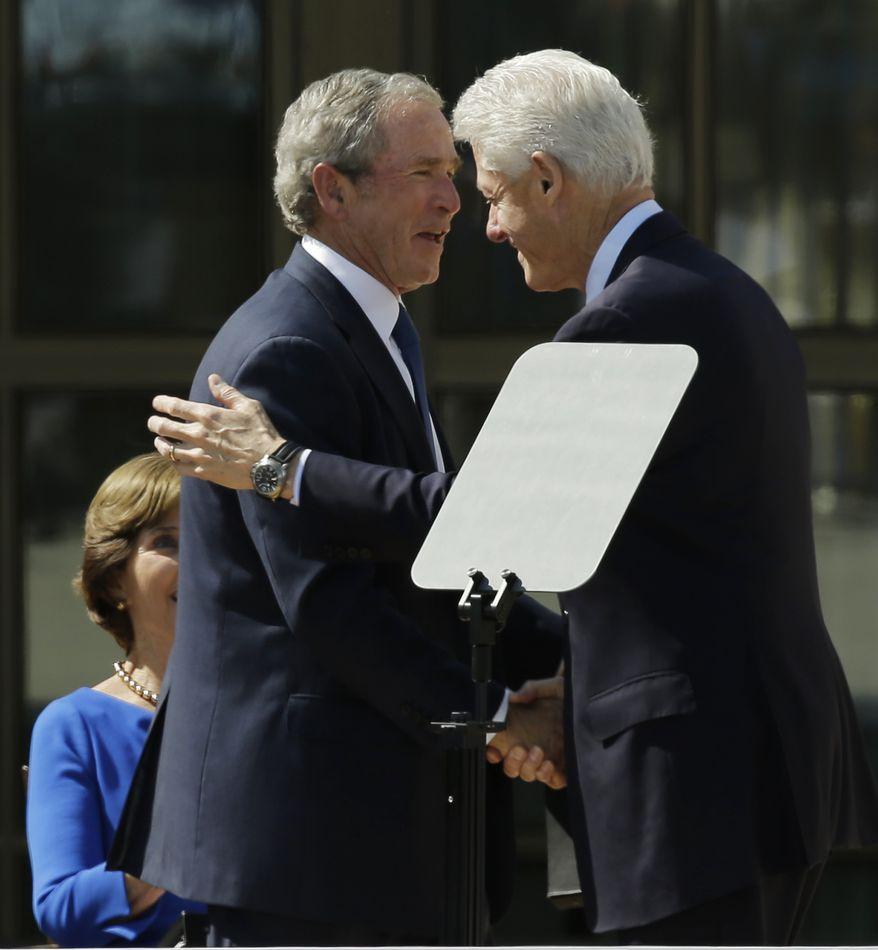 Former president George W. Bush, left, shakes hands with former president William J. Clinton during the dedication of the George W. Bush Presidential Center Thursday, April 25, 2013, in Dallas. (AP Photo/David J. Phillip)