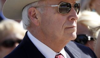 Former Vice President Dick Cheney wears a hat and sunglasses at the dedication of the George W. Bush Presidential Library on the campus of Southern Methodist University in Dallas on Thursday, April 25, 2013. (AP Photo/Charles Dharapak)