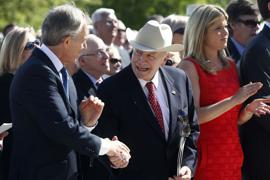 Former Vice President Dick Cheney, center, shakes hands with former British Prime Minister Tony Blair during the dedication of the George W. Bush presidential library on the campus of Southern Methodist University in Dallas, Thursday, April 25, 2013. Former President George W. Bush's daughter Jenna Bush Hager is at right. (AP Photo/Charles Dharapak)