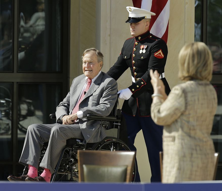 Former President George H.W. Bush arrives during the dedication of the George W. Bush Presidential Center, Thursday, April 25, 2013, in Dallas. (AP Photo/David J. Phillip)