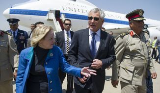 U.S. Secretary of Defense Chuck Hagel speaks with U.S. Ambassador to Egypt Anne Patterson, left, and Egyptian Central Military Zone Chief of Staff Maj. Gen. Mohammed Zamaloo upon his arrival in Cairo, on Wednesday, April 24, 2013. (AP Photo/Jim Watson, Pool)