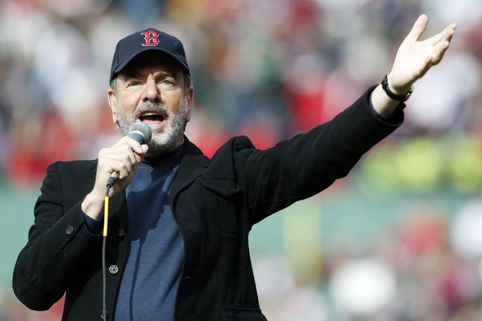 """Neil Diamond sings """"Sweet Caroline"""" in the eighth inning of a baseball game between the Boston Red Sox and the Kansas City Royals at Fenway Park in Boston on Saturday, April 20, 2013. (AP Photo/Michael Dwyer)"""