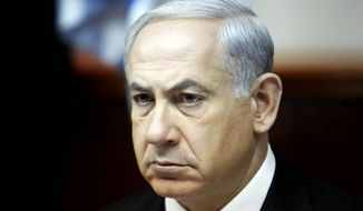 ** FILE ** Israel's Prime Minister Benjamin Netanyahu leads the weekly cabinet meeting in Jerusalem Sunday, April 21, 2013. (AP Photo/Gali Tibbon, Pool)