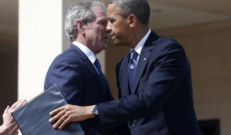 **FILE** President Obama embraces former President George W. Bush after he spoke at the dedication of Bush's presidential library on the campus of Southern Methodist University in Dallas on April 25, 2013. (Associated Press)