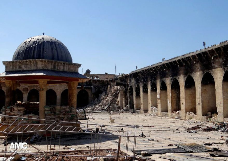 This journalism image provided by Aleppo Media Center AMC, which has been authenticated based on its contents and other AP reporting, shows the damaged famed 12th century Umayyad mosque without the minaret, background right corner, which was destroyed by the shelling, in the northern city of Aleppo, Syria, Wednesday April 24, 2013. (AP Photo/Aleppo Media Center, AMC)