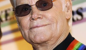 **FILE** Legendary country singer George Jones arrives Dec. 7, 2008, for the Kennedy Center Honors at the Kennedy Center in Washington. (Associated Press)