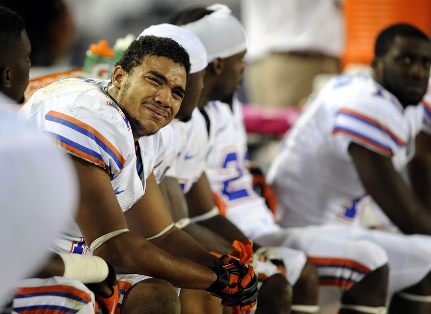 Florida tight end Jordan Reed (11) cries on the sidelines during the second half of an NCAA college football game against Georgia, Saturday, Oct. 27, 2012 in Jacksonville, Fla. Reed fumbled the ball near the goal line late in the game. Georgia beat Florida 17-9. (AP Photo/Stephen Morton)
