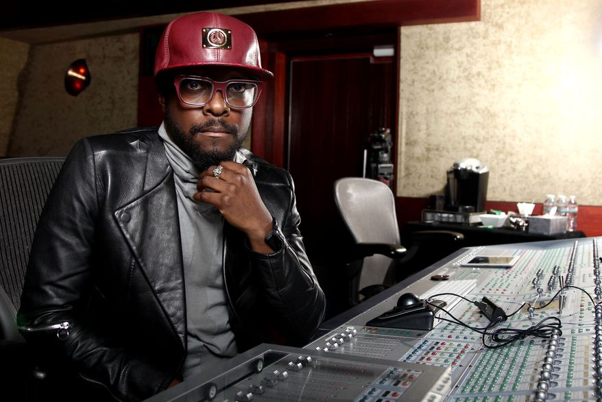 Will.i.am poses for a portrait in Los Angeles on April 24, 2013. (Matt Sayles/Invision/Associated Press)