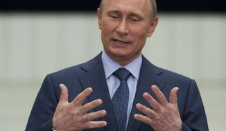 "** FILE ** Russian President Vladimir Putin gestures while speaking to the media after his annual call-in show on Russian television ""Conversation With Vladimir Putin"" in Moscow on Thursday, April 25, 2013. (AP Photo/Alexander Zemlianichenko)"