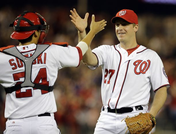 Jordan Zimmermann, right, is congratulated by Washington Nationals catcher Kurt Suzuki, left, after the right-hander tossed a complete-game, one-hit shutout over the Cincinnati Reds on Friday night. (Associated Press photo)