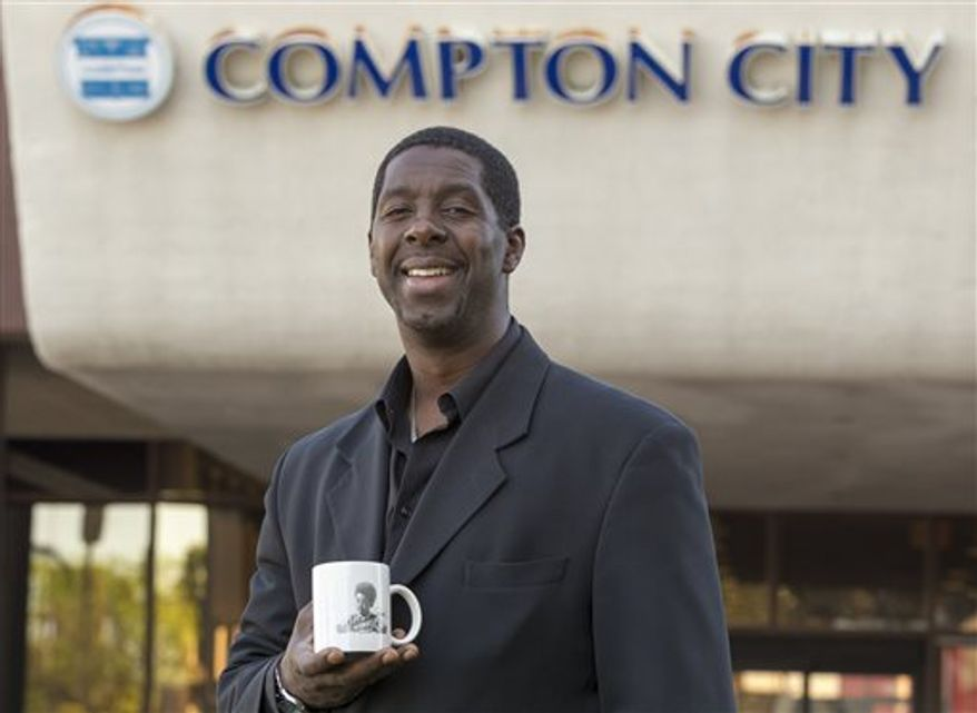 Former child actor Rodney Allen Rippy poses for a photo outside Compton City Hall in Compton, Calif. Rippy finished 10th of 12 candidates for Mayor of Compton in an election held earlier this month. (AP Photo/Damian Dovarganes)