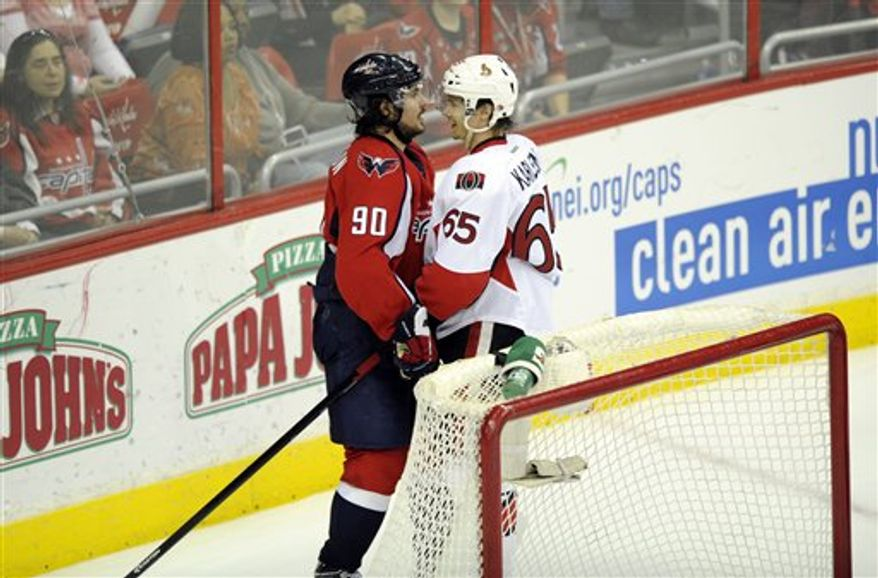 Ottawa Senators defenseman Erik Karlsson (65), of Sweden, stands next to Washington Capitals center Marcus Johansson (90), of Sweden, during the third period of an NHL hockey game, Thursday, April 25, 2013, in Washington. Ottawa won 2-1 in overtime. (AP Photo/Nick Wass)