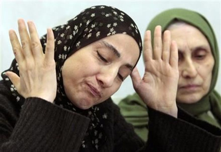 ** FILE ** The mother of the two Boston bombing suspects, Zubeidat Tsarnaeva, left, speaking at a news conference in Makhachkala, the southern Russian province of Dagestan, April 25, 2013. Two government officials tell The Associated Press that U.S. intelligence agencies added the Boston bombing suspects' mother to a federal terrorism database about 18 months before the attack. At right is her sister-in-law Maryam. (AP Photo/Musa Sadulayev, File)