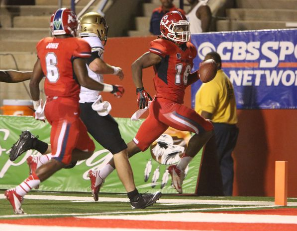 Fresno State's Phillip Thomas runs back a pick for a touchdown against Colorado in the third quarter of an NCAA college football game in Fresno, Calif., Saturday, Sept. 15, 2012. (AP Photo/Gary Kazanjian)