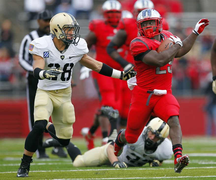 Rutgers' running back Jawan Jamison (23) looks back as he is chased by Army's Justin Allen (28) during the second quarter of an NCAA college football game in Piscataway, N.J., Saturday, Nov. 10, 2012. Rutgers defeated Army 28-7. (AP Photo/Rich Schultz)
