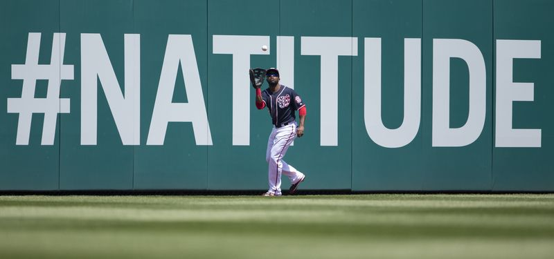 Washington Nationals center fielder Denard Span makes a catch on a fly ball hit by Cincinnati Reds' Joey Votto during the first inning of a baseball game at Nationals Park on Saturday, April 27, 2013, in Washington. (AP Photo/Evan Vucci)