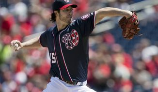 Washington Nationals starting pitcher Dan Haren delivers a pitch to the Cincinnati Reds during the first inning of a baseball game at Nationals Park on Saturday, April 27, 2013, in Washington. (AP Photo/Evan Vucci)