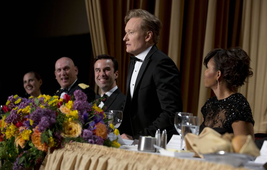 Christi Parsons, White House correspondent for the Chicago Tribune, Los Angeles Times and Tribune newspaper chain, from left, Chief of Staff Gen. Raymond T. Odierno, Michael Scherer, White House correspondent for TIME, late-night television host Conan O'Brien and first lady Michelle Obama attend the White House Correspondents' Association Dinner at the Washington Hilton Hotel, Saturday, April 27, 2013, in Washington. (AP Photo/Carolyn Kaster)