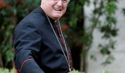 Cardinal Timothy M. Dolan, Roman Catholic archbishop of New York, on Saturday received the William Wilberforce Award from the Chuck Colson Center for Christian Worldview. (Associated Press)