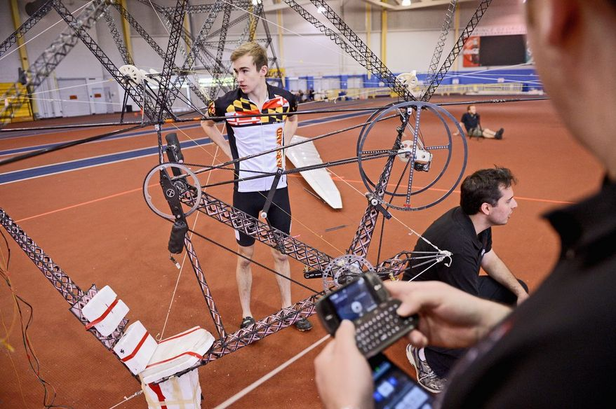 Volunteer pilot Henry Enerson gets ready for a test flight Sunday with the University of Maryland's Team Gamera that is trying to win a $250,000 prize with their human-powered helicopter. (Andrew Harnik/The Washington Times)