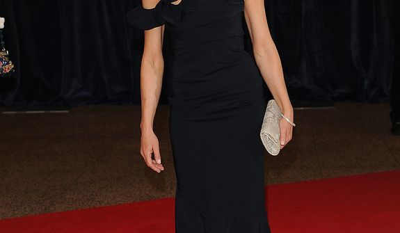 """Actress Robin Wright of the Washington-set Netflix series """"House of Cards"""" attends the White House Correspondents' Association Dinner at the Washington Hilton Hotel on Saturday, April 27, 2013, in Washington. (Evan Agostini/Invision/AP)"""