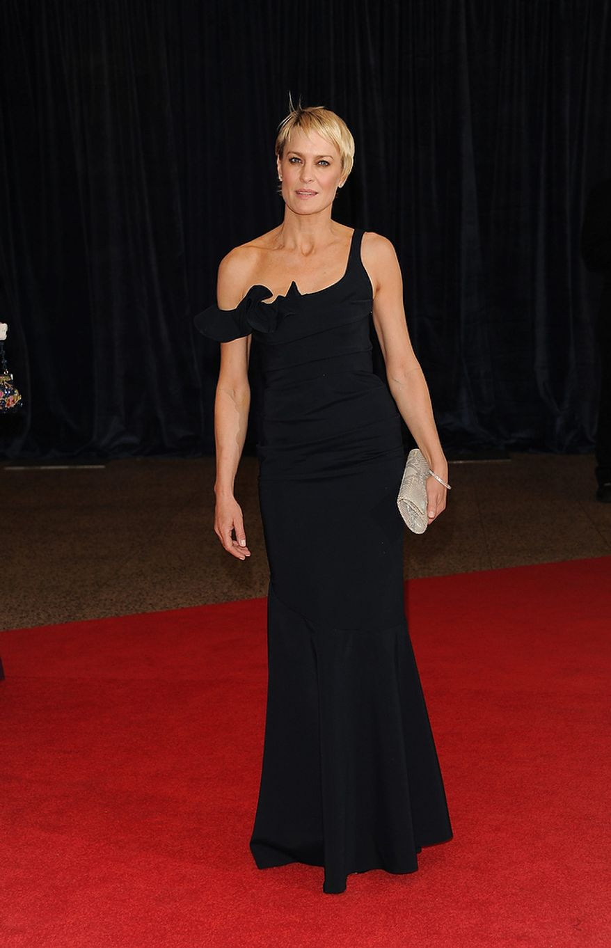 "Actress Robin Wright of the Washington-set Netflix series ""House of Cards"" attends the White House Correspondents' Association Dinner at the Washington Hilton Hotel on Saturday, April 27, 2013, in Washington. (Evan Agostini/Invision/AP)"
