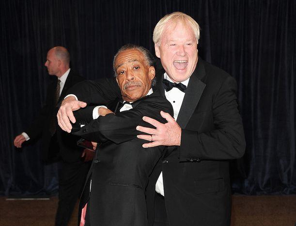 "** FILE ** ""Hardball"" host Chris Matthews bear hugs the Rev. Al Sharpton (left) at the at the Washington Hilton Hotel on April 27, 2013. (Associated Press)"