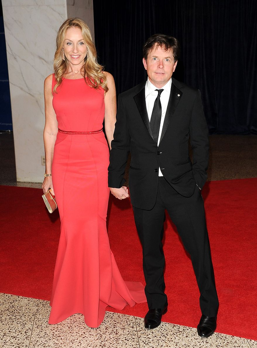 Actors Michael J. Fox and his wife, Tracy Pollan, attend the White House Correspondents' Association Dinner at the Washington Hilton Hotel on Saturday, April 27, 2013, in Washington. (Evan Agostini/Invision/AP)