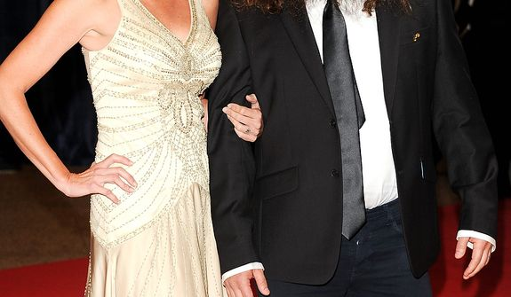 """Korie Robertson (left) and Willie Robertson of the A&E series """"Duck Dynasty"""" attend the White House Correspondents' Association Dinner at the Washington Hilton Hotel on Saturday, April 27, 2013, in Washington. (Evan Agostini/Invision/AP)"""