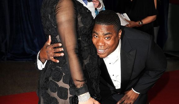 Actor Tracy Morgan and his pregnant girlfriend, Meghan Wollover, attend the White House Correspondents' Association Dinner at the Washington Hilton Hotel on Saturday, April 27, 2013, in Washington. (Evan Agostini/Invision/AP)