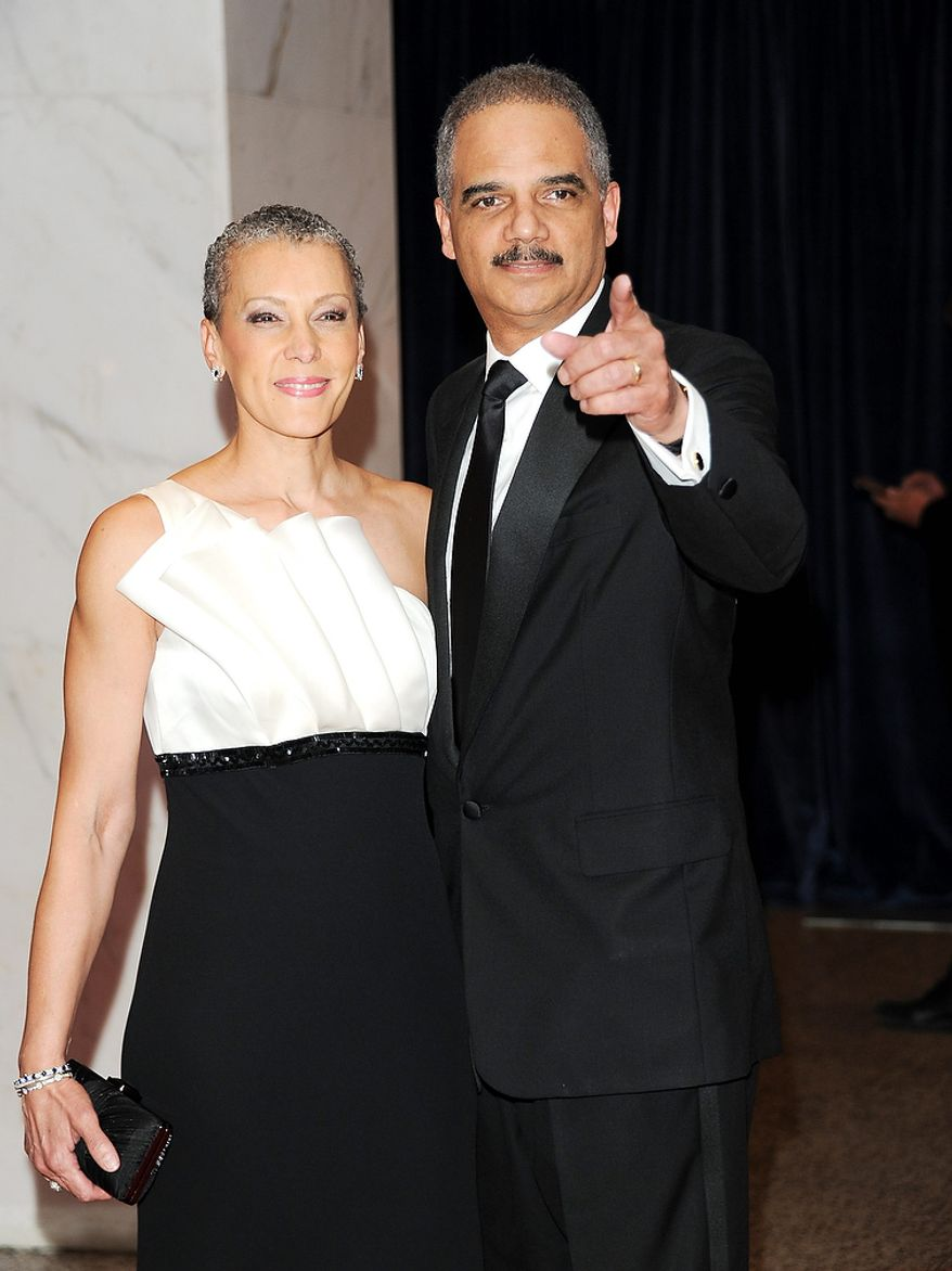 Attorney General Eric H. Holder Jr. and his wife, Sharon Malone Holder, attend the White House Correspondents' Association Dinner at the Washington Hilton Hotel on Saturday, April 27, 2013, in Washington. (Evan Agostini/Invision/AP)