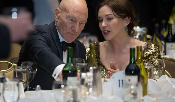 Actor Patrick Stewart (left) attends the White House Correspondents' Association Dinner at the Washington Hilton Hotel on Saturday, April 27, 2013, in Washington. (AP Photo/Carolyn Kaster)