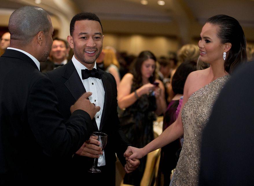 Singer John Legend and model Chrissy Teigen attend the White House Correspondents' Association Dinner at the Washington Hilton Hotel on Saturday, April 27, 2013, in Washington. (AP Photo/Carolyn Kaster)