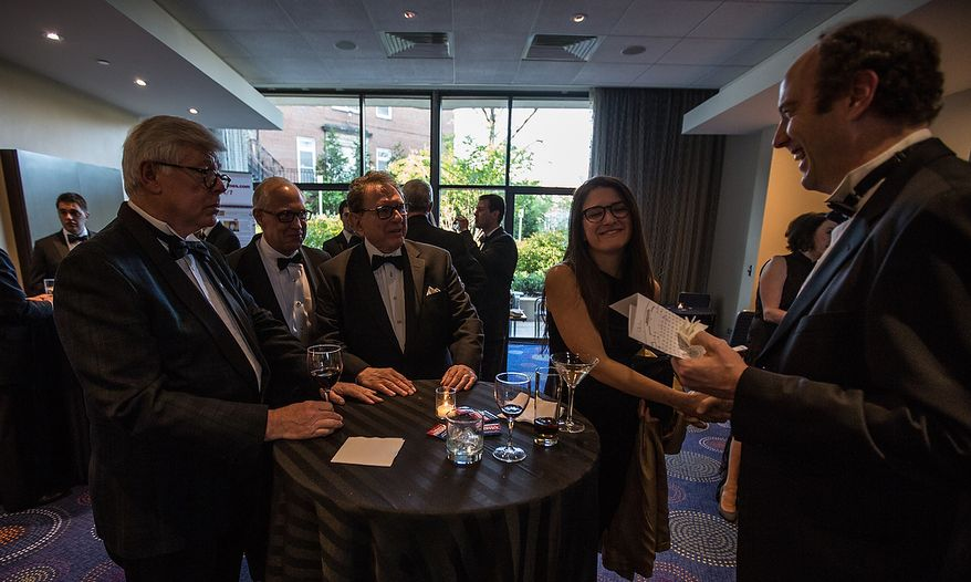 David Keene (left), president of the National Rifle Association, mingles with guests and representatives of The Washington Times at the newspaper's reception at the White House Correspondents' Association Dinner at the Washington Hilton Hotel in Washington on Saturday, April 27, 2013. (Andrew S. Geraci/The Washington Times)