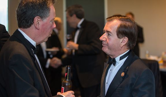 Rep. Edward R. Royce (right) speaks with representatives of The Washington Times at the newspaper's reception at the White House Correspondents' Association Dinner at the Washington Hilton Hotel in Washington on Saturday, April 27, 2013. (Andrew S. Geraci/The Washington Times)