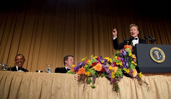 President Obama (left) and White House Correspondents' Association President Ed Henry (center), chief White House correspondent for Fox News, laugh as late-night television host and comedian Conan O'Brien speaks during the White House Correspondents' Association Dinner at the Washington Hilton Hotel on Saturday, April 27, 2013, in Washington. (AP Photo/Carolyn Kaster)