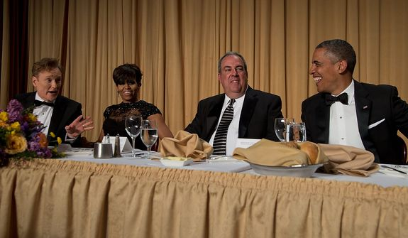 Late-night television host and comedian Conan O'Brien (from left); first lady Michelle Obama; Michael Clemente, executive vice president of Fox News; and President Obama attend the White House Correspondents' Association Dinner at the Washington Hilton Hotel on Saturday, April 27, 2013, in Washington. (AP Photo/Carolyn Kaster)