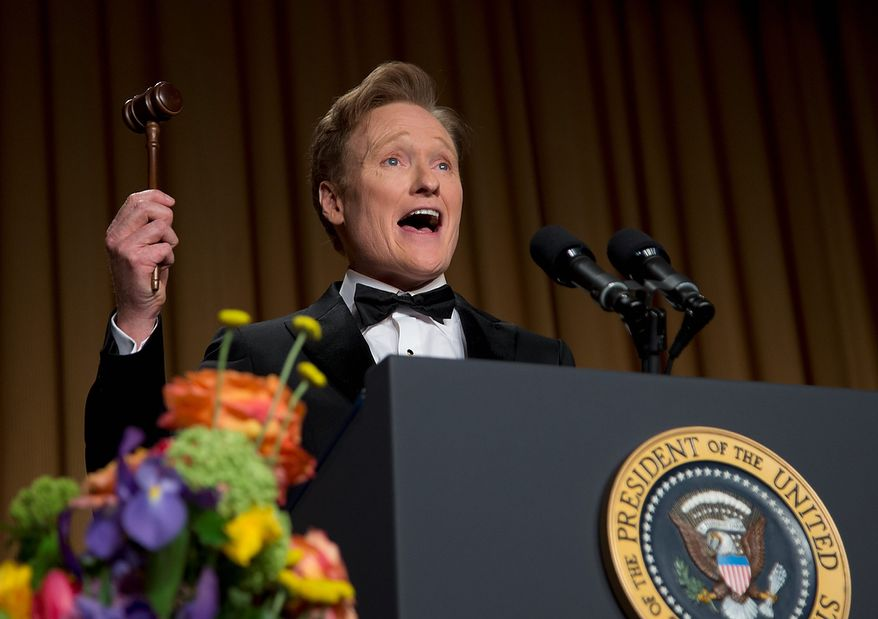 Late-night television host and comedian Conan O'Brien holds a gavel as he speaks during the White House Correspondents' Association Dinner at the Washington Hilton Hotel on Saturday, April 27, 2013, in Washington. (AP Photo/Carolyn Kaster)