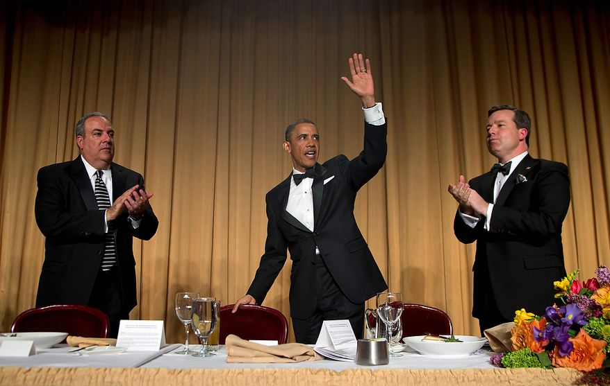President Obama, flanked by Michael Clemente (left), executive vice president of Fox News, and White House Correspondents' Association President Ed Henry (right), chief White House correspondent for Fox News, waves to the audience after speaking at the White House Correspondents' Association Dinner at the Washington Hilton Hotel on Saturday, April 27, 2013, in Washington. (AP Photo/Carolyn Kaster)