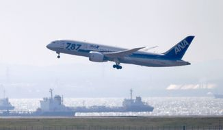"A Boeing 787 ""Dreamliner"" aircraft belonging to Japan's All Nippon Airways takes off from Haneda Airport in Tokyo at the start of a test flight on Sunday, April 28, 2013. (AP Photo/Kyodo News)"