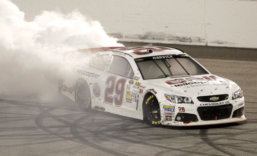 Kevin Harvick does a burnout as he celebrates winning the Toyota Owner's 400 NASCAR Sprint Cup series auto race at Richmond International Raceway in Richmond, Va., Saturday April 27, 2013. (AP Photo/Steve Helber)