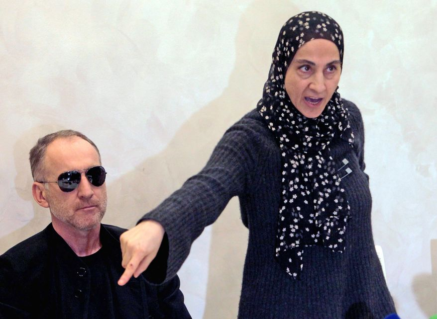 Zubeidat Tsarnaeva, the mother of the two Boston Marathon bombing suspects, said in this 2013 file photo that authorities were wrong to suspect her sons of the bombings. Her husband, Anzor Tsarnaev, is beside her. (Associated Press) ** FILE **