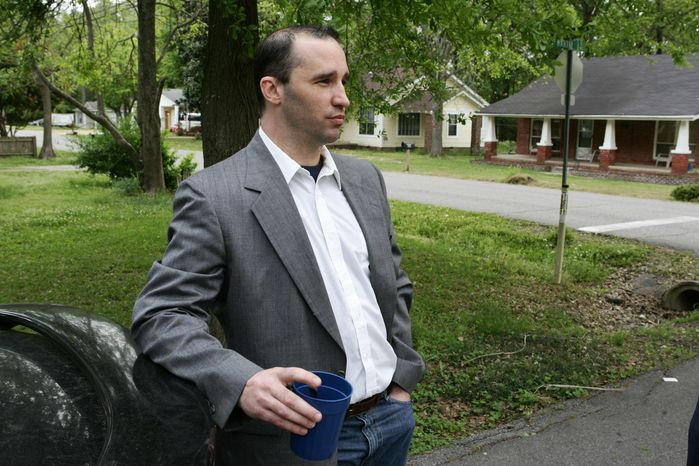 ** FILE ** In this Tuesday April 23, 2013, file photo, Everett Dutschke stands in the street near his home in Tupelo, Miss., and waits for the FBI to arrive and search his home. (AP Photo/Northeast Mississippi Daily Journal, Thomas Wells, File)