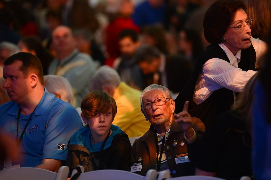 Ilse F. Camis (right), a Holocaust survivor from Vienna, Austria, sits with her great-great-grandson Thomas Gorenflo III, 12, of Detroit before the start of the U.S. Holocaust Memorial Museum's 20th-anniversary commemoration and national tribute to Holocaust survivors and World War II veterans in Washington on Monday, April 29, 2013. (Andrew Harnik/The Washington Times)