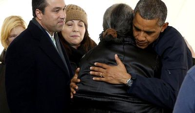 Rep. Michael G. Grimm (left) joins President Obama on a visit to the FEMA recovery center on the grounds of New Dorp High School on Thursday, Nov. 15, 2012, in the New York borough of Staten Island. (AP Photo/Carolyn Kaster)