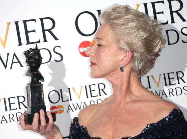 """Helen Mirren won the best actress award for her portrayal of Queen Elizabeth II in """"The Audience"""" at the 2013 Olivier Awards, presented at the Royal Opera House in London on Sunday, April 28, 2013. (Joel Ryan/Invision/AP)"""