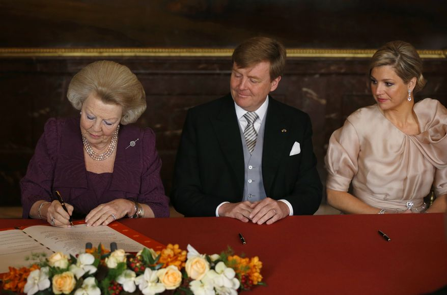 Dutch Queen Beatrix (left) signs the Act of Abdication in favor of her son Prince Willem-Alexander (center), who became the first Dutch king in more than a century, in the Mozeszaal, or Moses Hall, of the Royal Palace in Amsterdam on Tuesday, April 30, 2013. With them is Princess Maxima, Willem-Alexander's wife, who became queen. (AP Photo/Bart Maat, Pool)