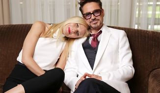 "There's something of the old married couple about Gwyneth Paltrow and Robert Downey Jr., though they're married to other people. They're cozy and comfy sitting down together for an interview in Los Angeles to promote ""Iron Man 3,"" opening Friday. (Photo by Eric Charbonneau/Invision/AP)"