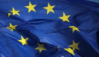 A European Union flag waves in the wind in front of the Chancellery in Berlin on Oct. 12, 2012. **FILE**